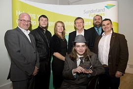 Image of the project team with their award
